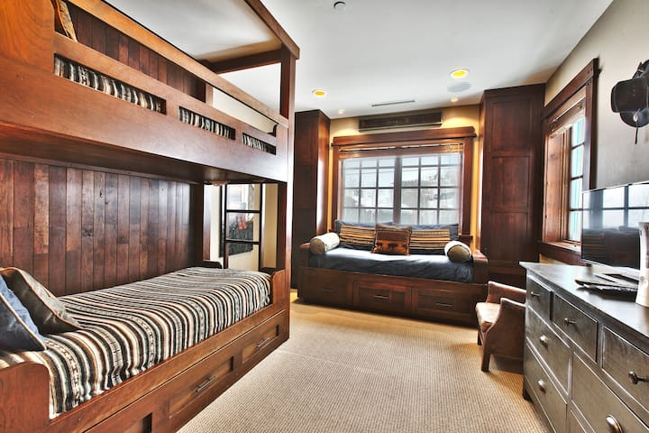 Third bedroom has hand-built cherry-wood bunk bed with trundle and custom twin size window bed.