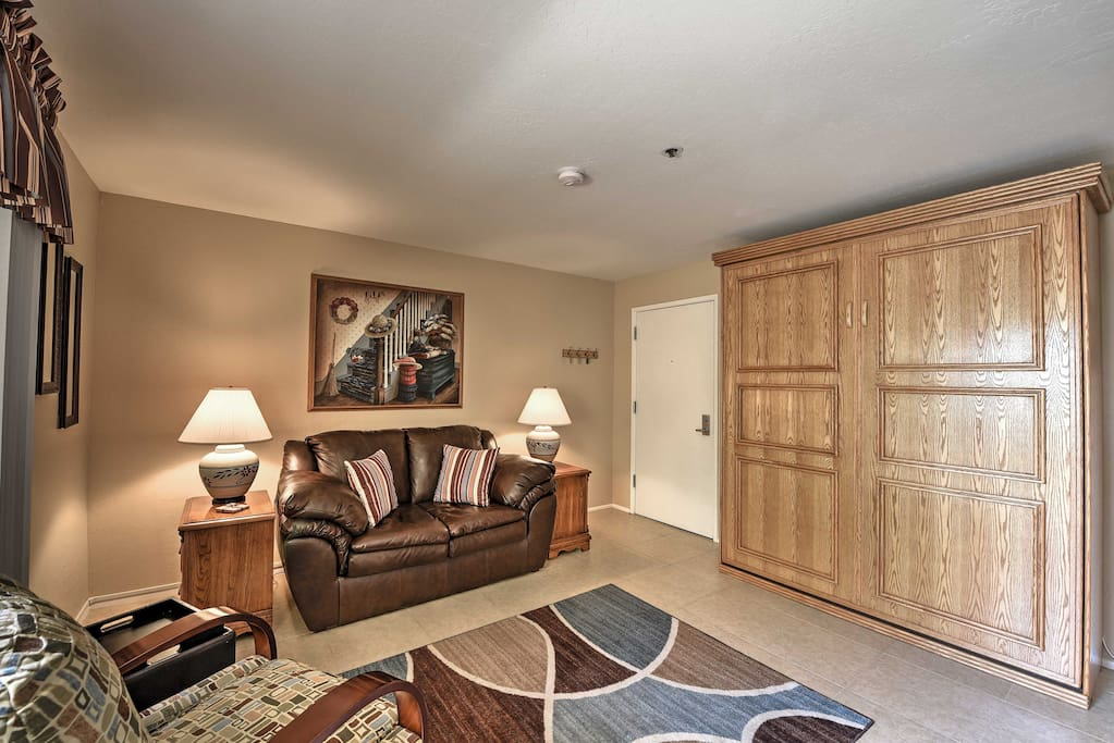 Enter inside this open layout condo featuring colorful art and decorations, sure to make you feel right at home.