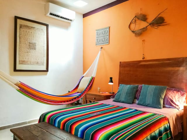 Air conditioner and hammock for those afternoon siestas