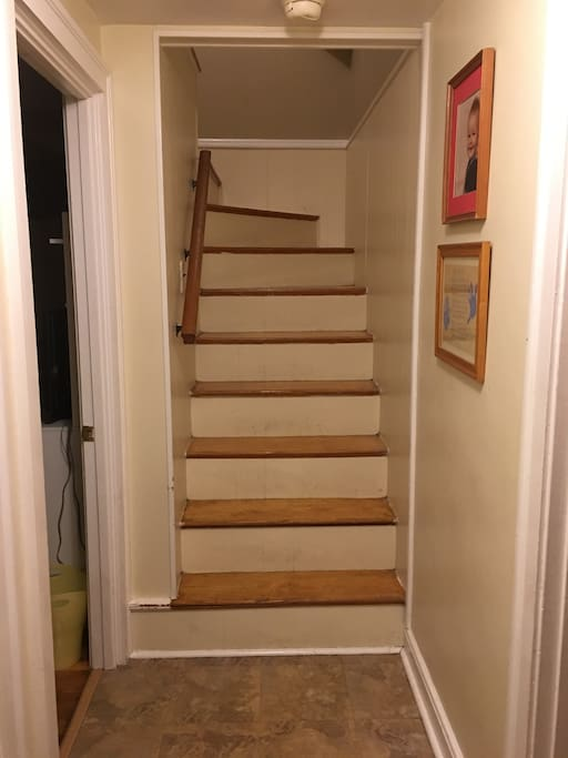 The stairs going up to the bedroom