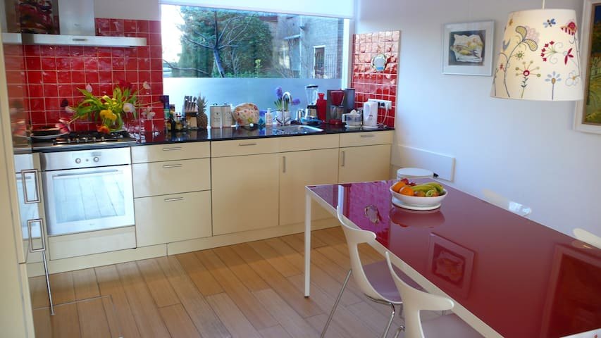 Kitchen with dishwasher and practical appliances.