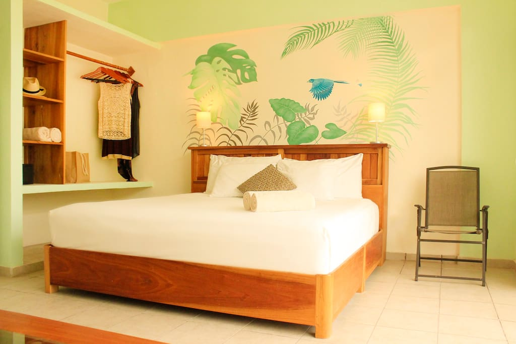 King bed, closet, sofa that can pull out for third guest. Caribbean colors highlight this large comfortable studio apartment