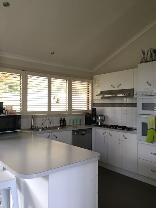Kitchen with breakfast bar for lazy morning brunches