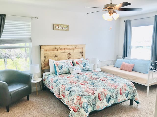 """Master suite with queen bed and custom headboard as well as twin size daybed! Room features a 43"""" TV for relaxation! Enjoy the view of the marshland outside with regular sightings of cranes, deer and eagles!"""