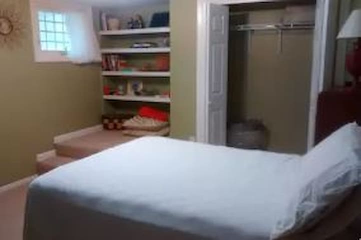 #1 large guest bedroom (two windows) with double-bed in basement.