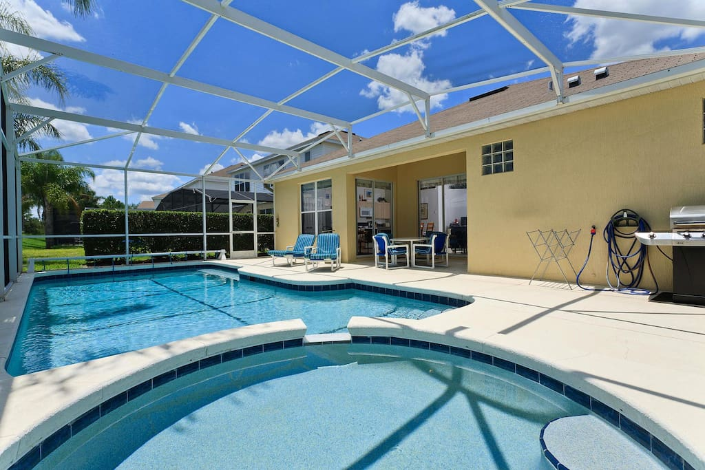 South-facing private screened pool with spillover spa & barbecue grill