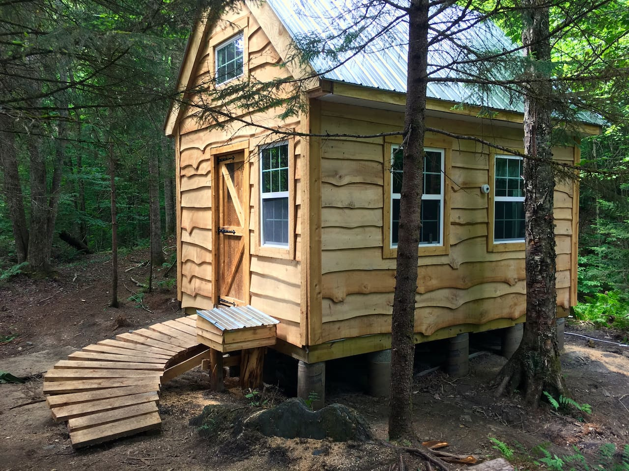 Complete with an ewok bridge, this cabin was built to fit in with the knoll-covered landscape around it.