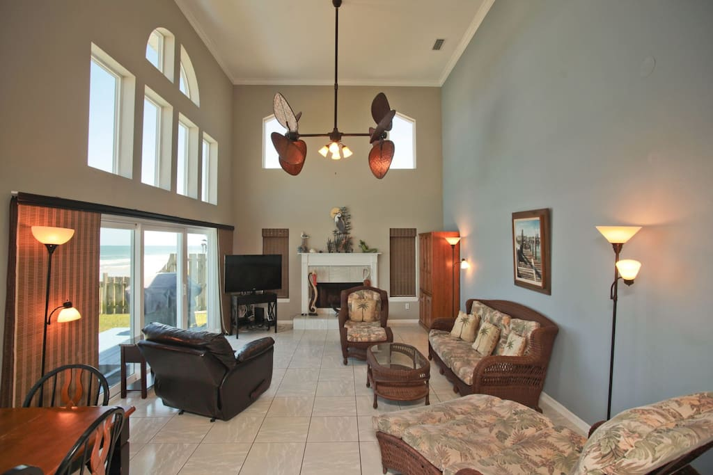 Beachside Paradise has a spacious living and dining room for your family to enjoy