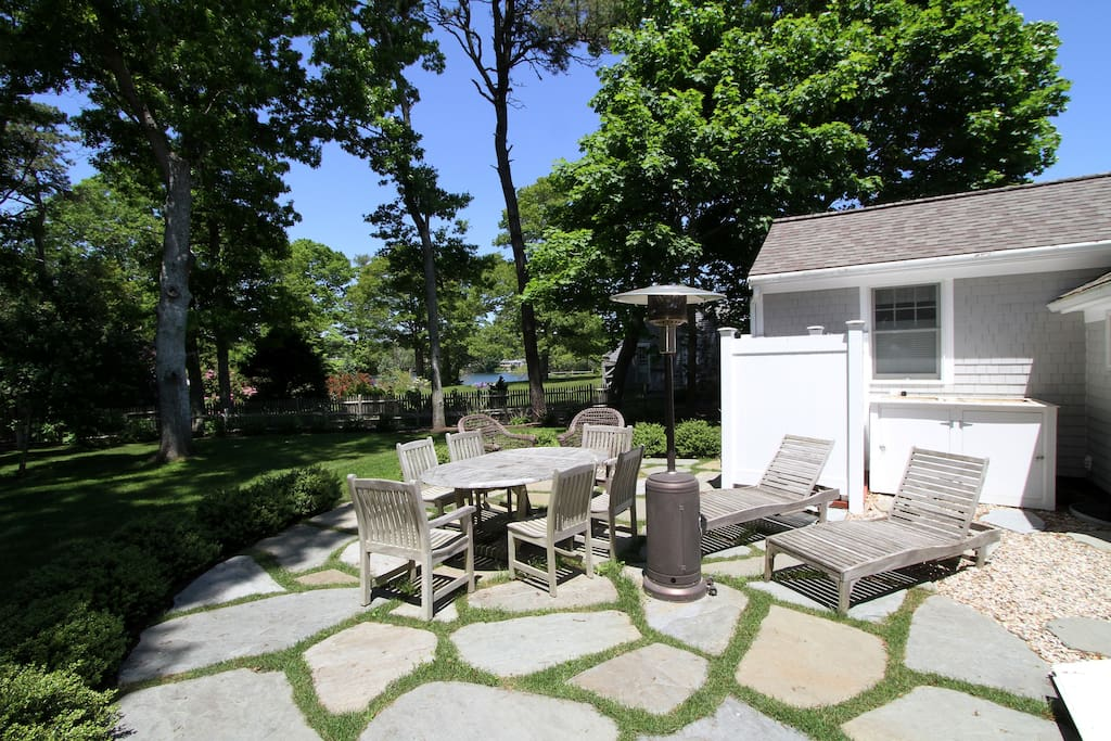 Relax in the great outdoors on a private stone patio.