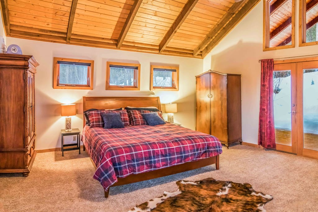 Huge Master Bedroom with king size bed, reading area with loveseat and back porch!