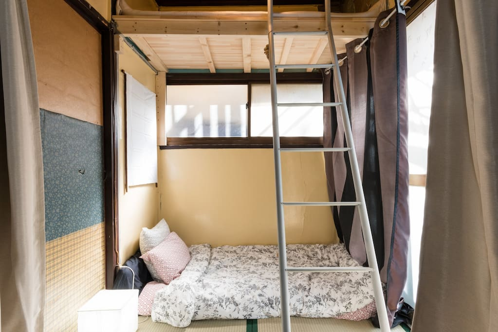 One attic bed and one futon below (or can put two futons side by side below and use attic bed for storage)