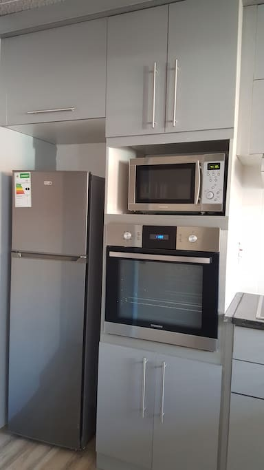 Each apartment has appliances and kitchen utensils