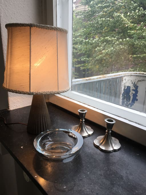 Carnap in the studio with ceramic lamp, Danish royal antique holmegaard Bowl and silver candle antique by Just.