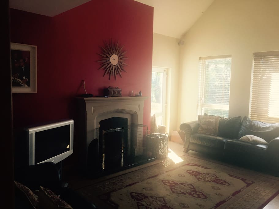 The spacious sitting room with open fire