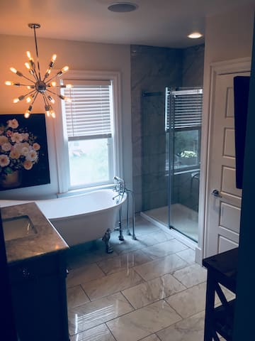 Beautiful bathroom with claw foot tub.