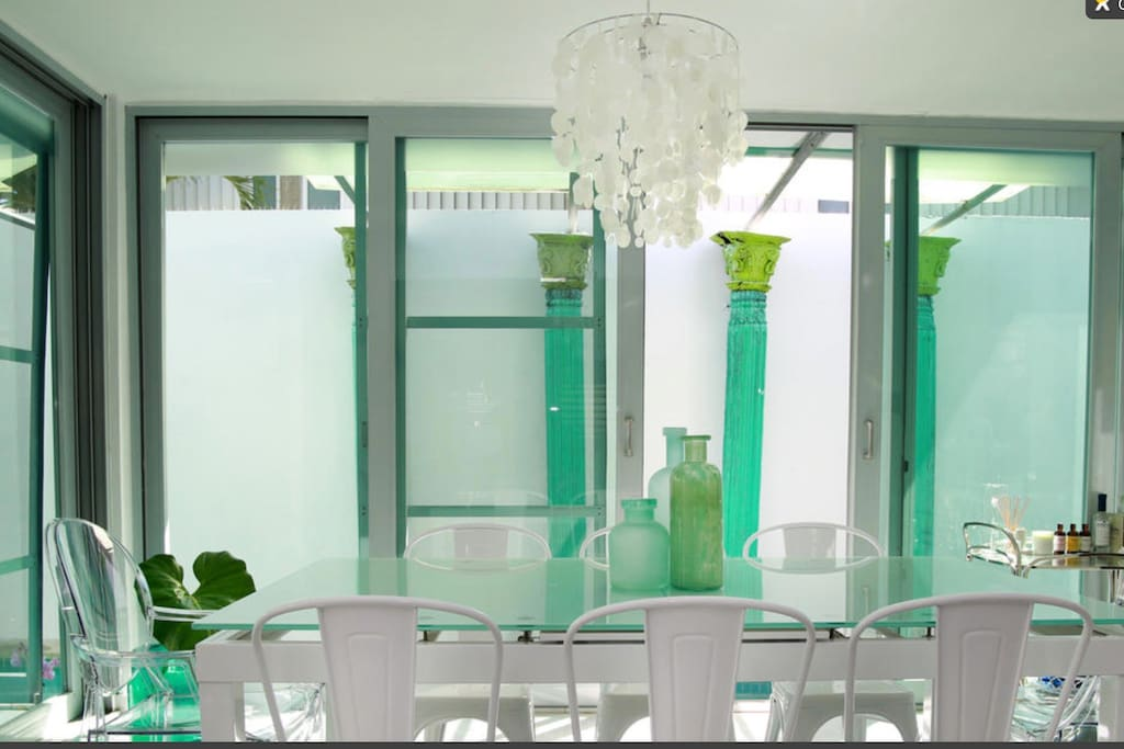 Dining area overlooking the pool. Seats 8.