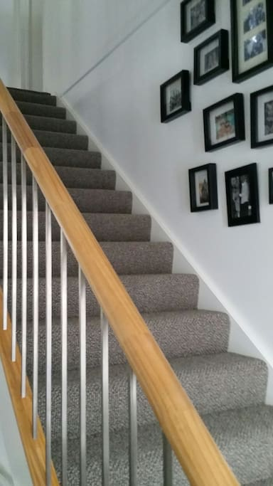 Stairs from front door to your private  bedroom and lounge