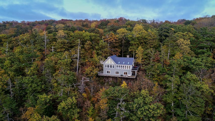 Spectacular Home offers Beautiful Views on a High Bluff w/ Private Lake!