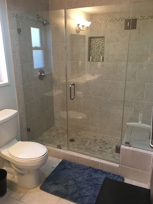 Beautiful tile shower with glass doors.