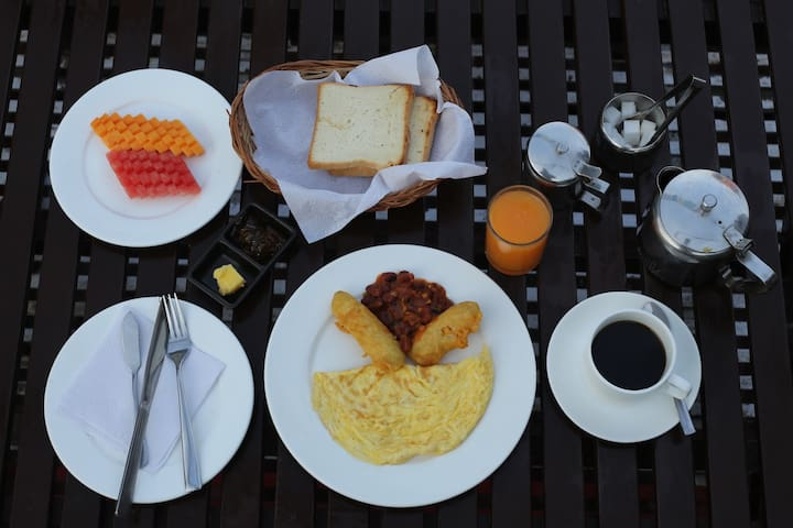 freshly prepared breakfast every morning different with free flow of mood enhancing coffee freshly roasted himalayan coffee beans and choices of himalayan tea with fresh seasonal fruits