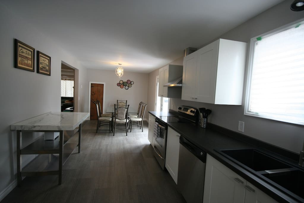 New, new, new! Spacious, modern and luxurious kitchen combined with the dining room.