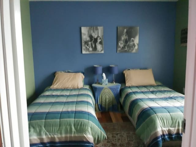 Nice and cosy bedroom with 2  beds and shared bath