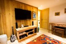 Entertainment room with games console, Tv and books
