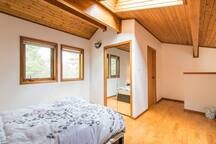 Upstairs bedroom with skylight