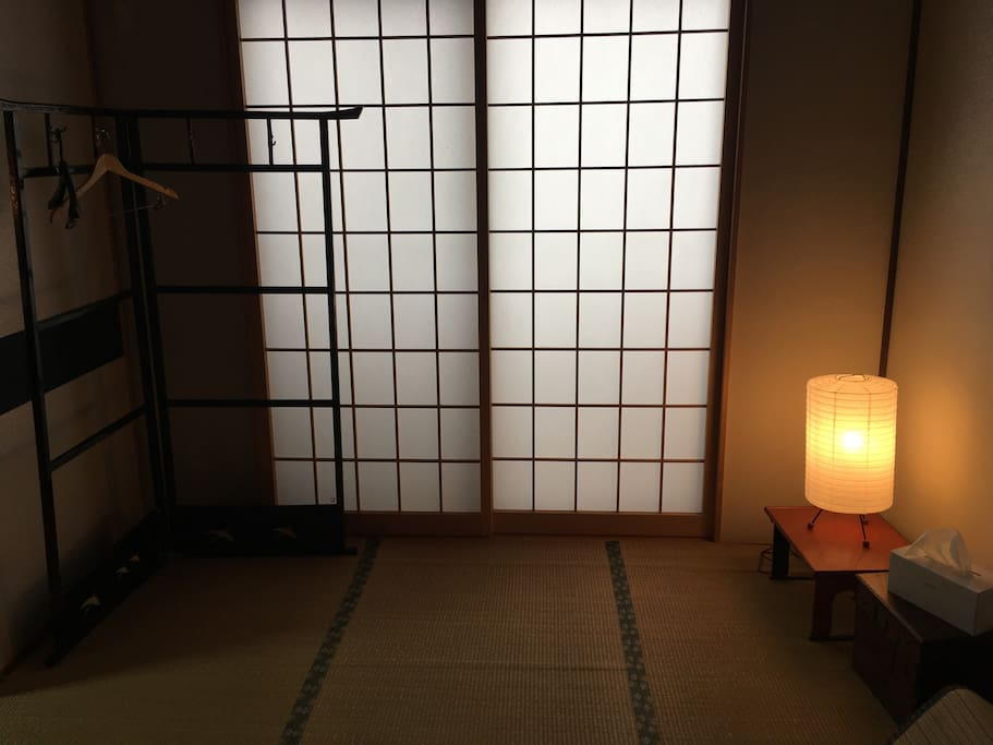 Ground floor tatami bedroom. To the right is a private bathroom.