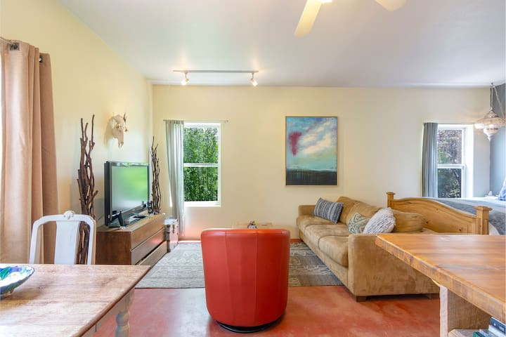 The living room space features cozy furniture, TV and sound system.