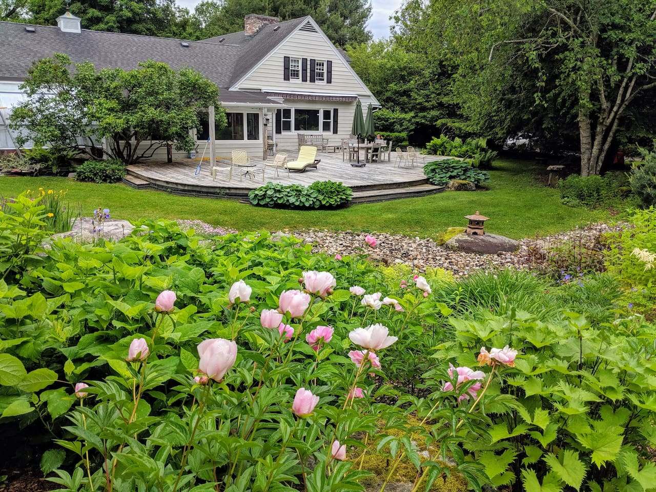 Our large beautiful back deck overlooking the gardens.  Plenty of room to relax, meditate, do tai chi or yoga, to the sound of our small waterfall and frog pond