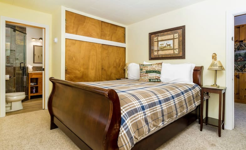 Get a good night's sleep on the comfy queen size mattress with cozy bedding (master bedroom)