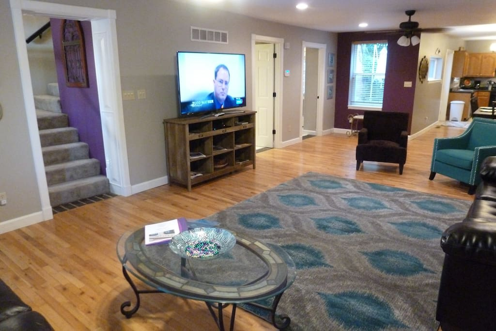 "Great room with 60"" flat panel with Direct TV."