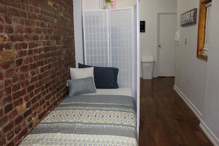 "This is a proper single bed and NOT those uncomfortable ""Sofa bed""-   The entire living space/ corridor space is just for you as I do not live in the apt.  Kitchen and bathroom is shared.  You can cover your entire bed space with foldable  and moveable room divider / Partition for complete privacy."