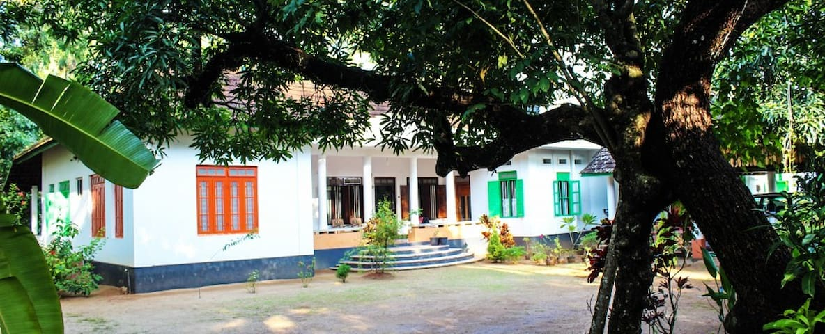 Gramam Homestay - Heritage Room with garden view.