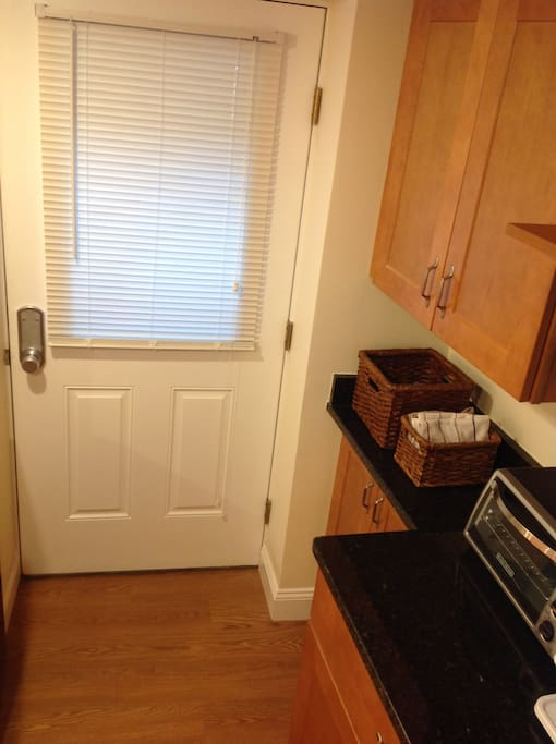 This unit is basement level with a single room with a private entrance from the exterior with its own sidewalk leading to the entrance stairs.