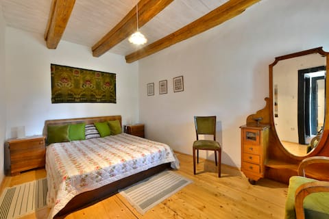 Cherry Orchard Cottage-  bedroom-and-kitchen