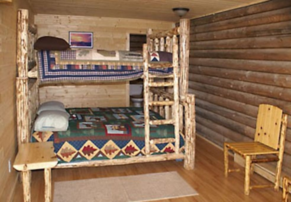 The 'Augustine Room' is appointed with Ken's handcrafted log furniture, comfortable mattresses and cozy bedding