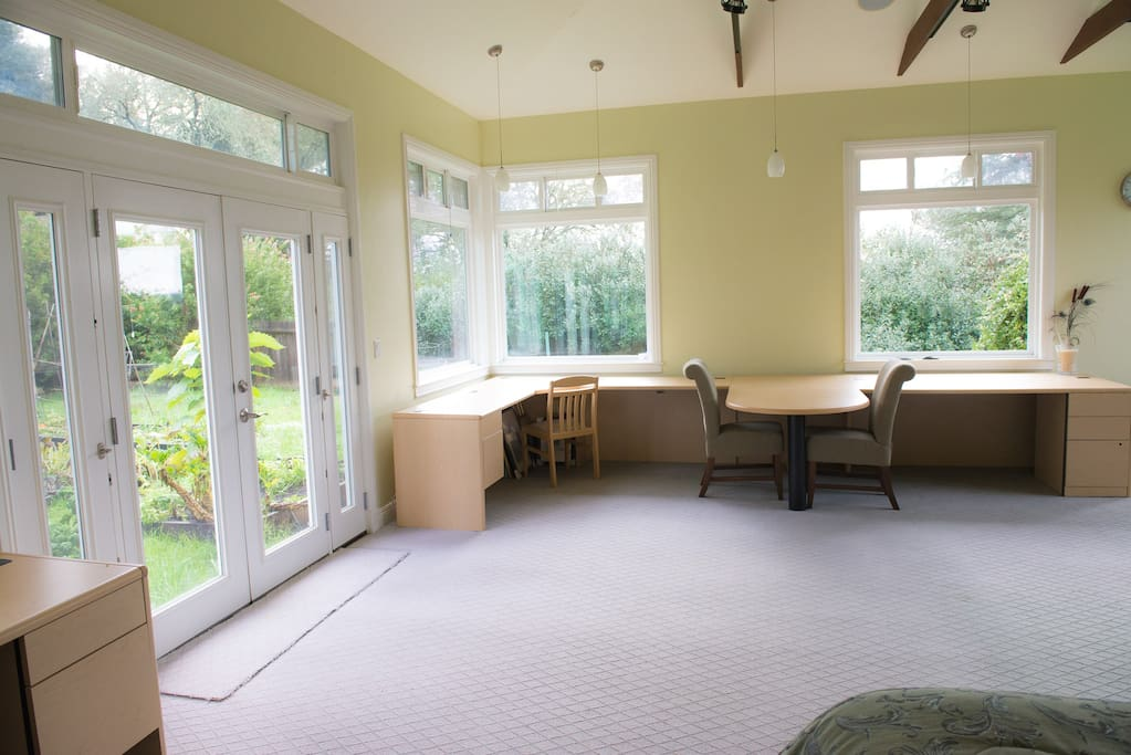 French doors open onto a private garden, perfect for morning meditation or just coffee in a peaceful sit spot