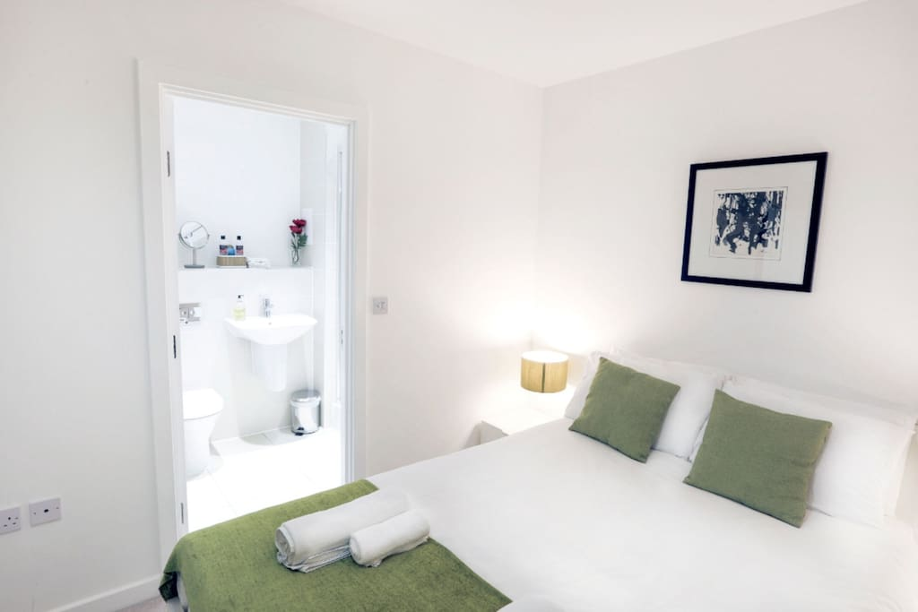 Comfortable and airy, the master bedroom is the perfect sanctuary to relax in, after a long day of sight-seeing.