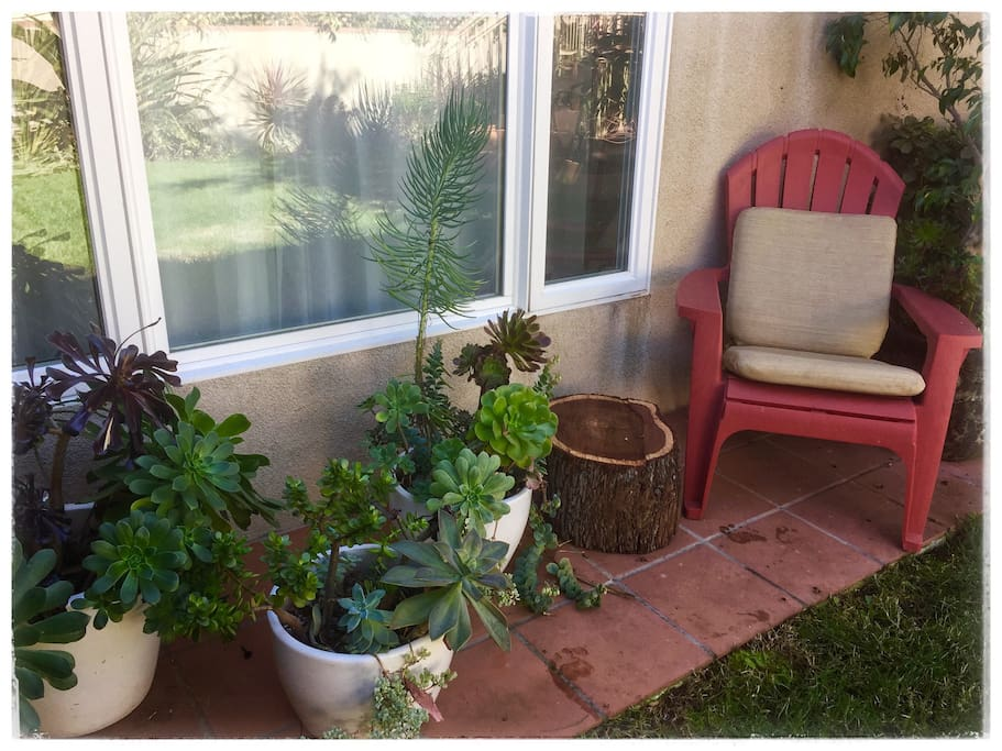 Outside sitting area with comfortable Adirondack chair for reading and enjoying the view.