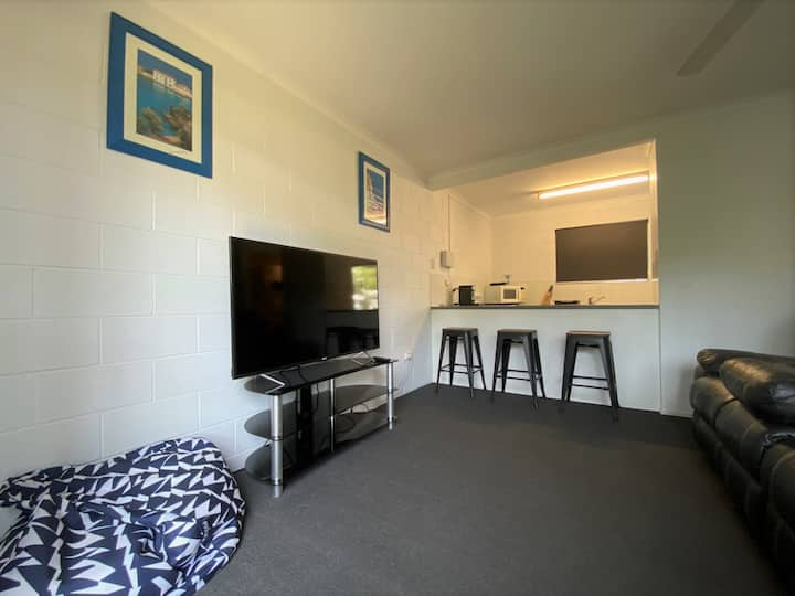Two Bedroom townhouse with pool, walk to Strand