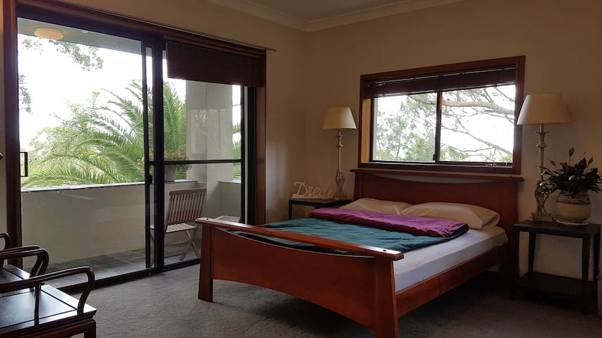 Bedrooms with private balcony and lush outlooks. - Frenchs Forest