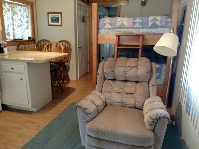 Comfy handmade double bunk bed and breakfast bar will delight you.