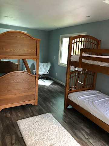 This room has two single bunk beds for guests.