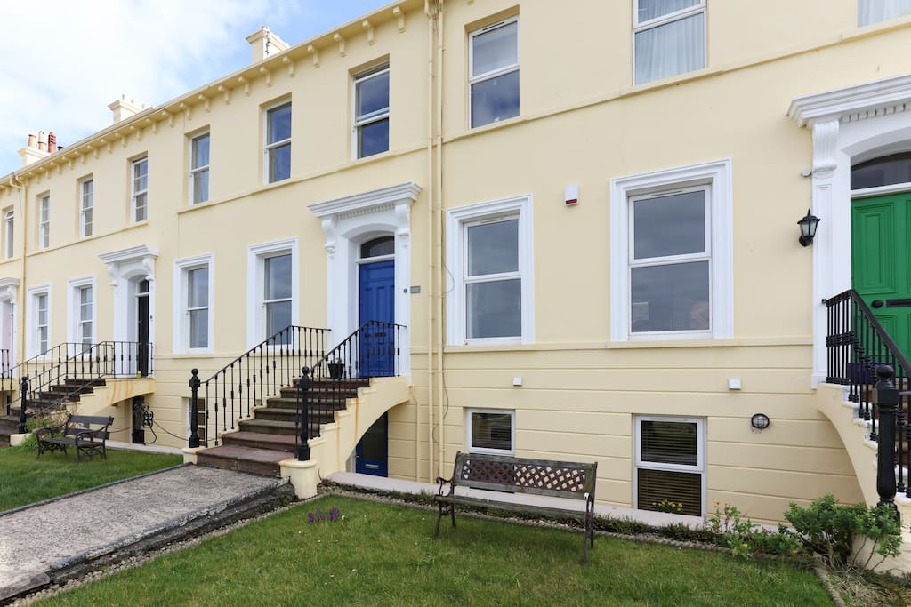 The apartment is on the ground floor of this 3 storey Victorian terrace.