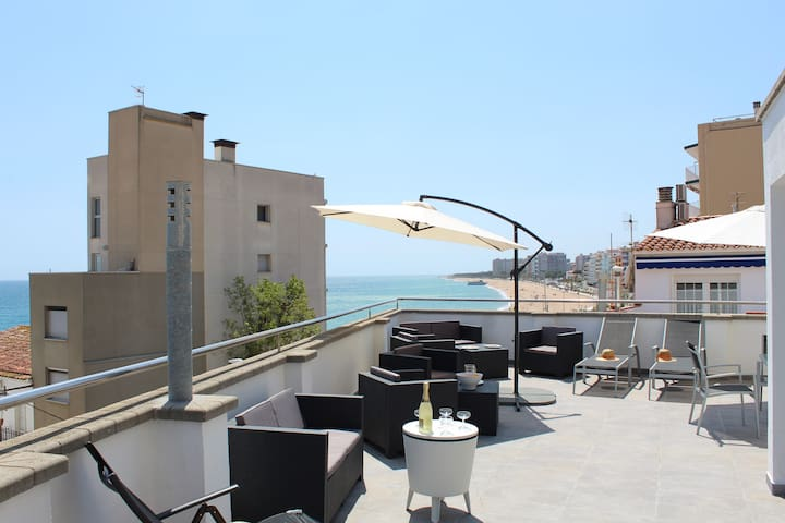 Large roof terrace with ocean views.