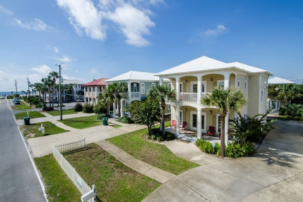 Almost right on the beach. Notice the two-story carriage/guest house included with this home.
