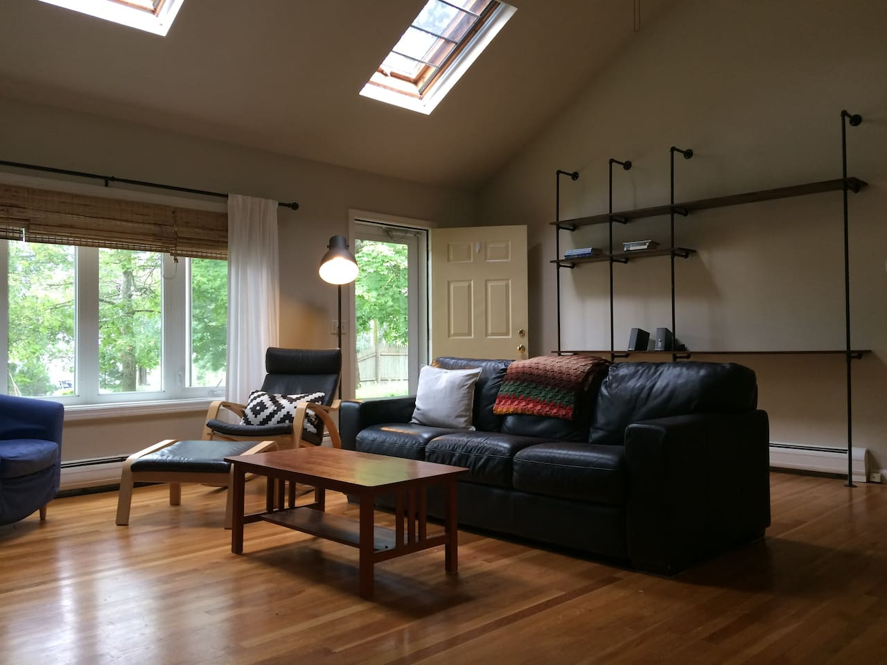 The heart of the house is this breezy, skylit living room with a cathedral ceiling.