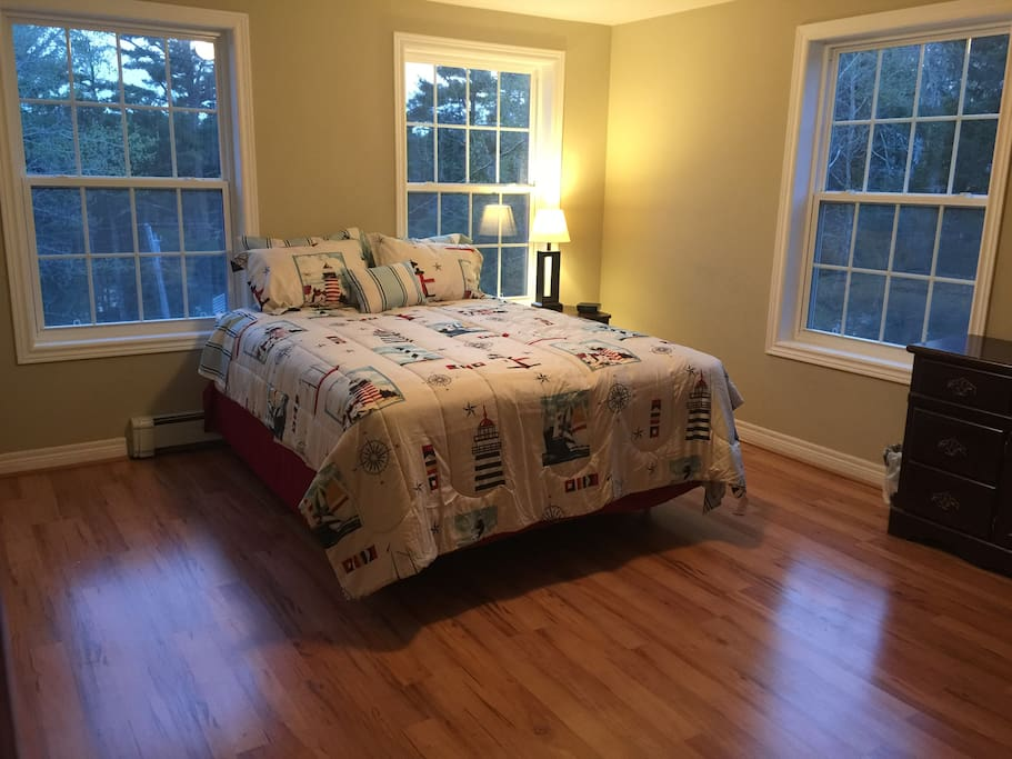This is the largest/master bedroom with a queen sized bed, walk-in closet, dresser, night stand, desk and attached full bath (with both shower and jetted tub).